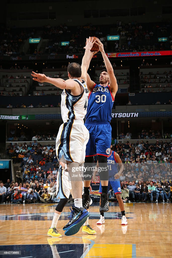 Byron Mullens of the Philadelphia 76ers shoots against the Memphis Grizzlies on April 11 2014 at FedExForum in Memphis Tennessee NOTE TO USER User...