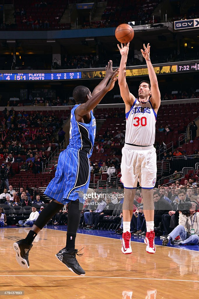 Byron Mullens of the Philadelphia 76ers takes a shot against the Orlando Magic on February 26 2014 at the Wells Fargo Center in Philadelphia...