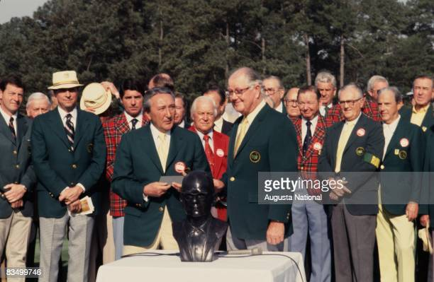 Byron Nelson and Chairman Bill Lane honor Clifford Roberts with a bronze bust during the 1978 Masters Tournament at Augusta National Golf Club in...