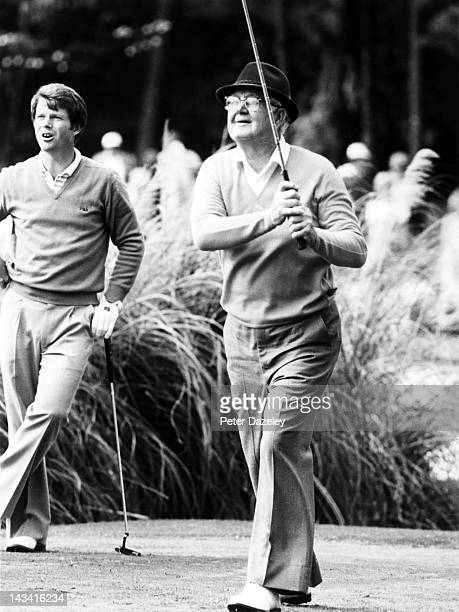 Byron Nelson of the USA tees off watched by Tom Watson of the USA during the par 3 contest during the 1981 Masters Tournament at Augusta National...