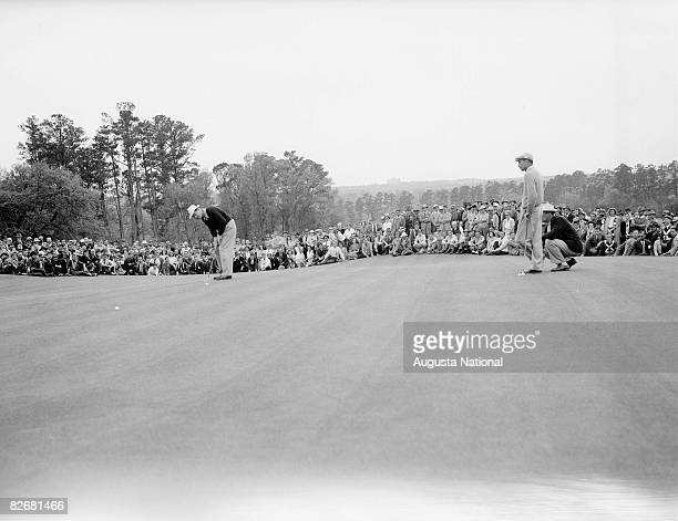 Byron Nelson sinks his putt to get into a playoff with Ben Hogan during the 1942 Masters Tournament at Augusta National Golf Club in April 1942 in...