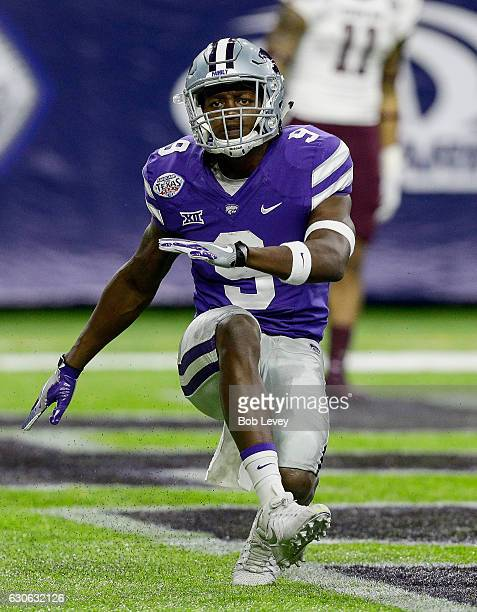 Byron Pringle of the Kansas State Wildcats celebrates after a 79 yard touchdown reception against the Texas AM Aggies in the AdvoCare V100 Texas Bowl...