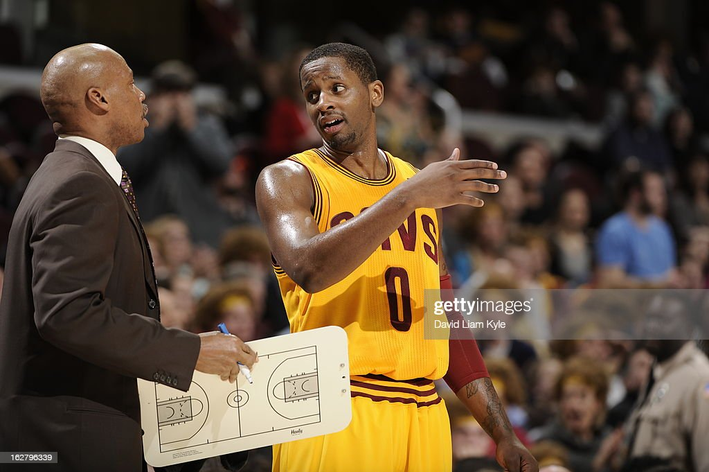 Byron Scott and C.J. Miles #0 of the Cleveland Cavaliers discuss a play during the game against the Atlanta Hawks at The Quicken Loans Arena on December 28, 2012 in Cleveland, Ohio.