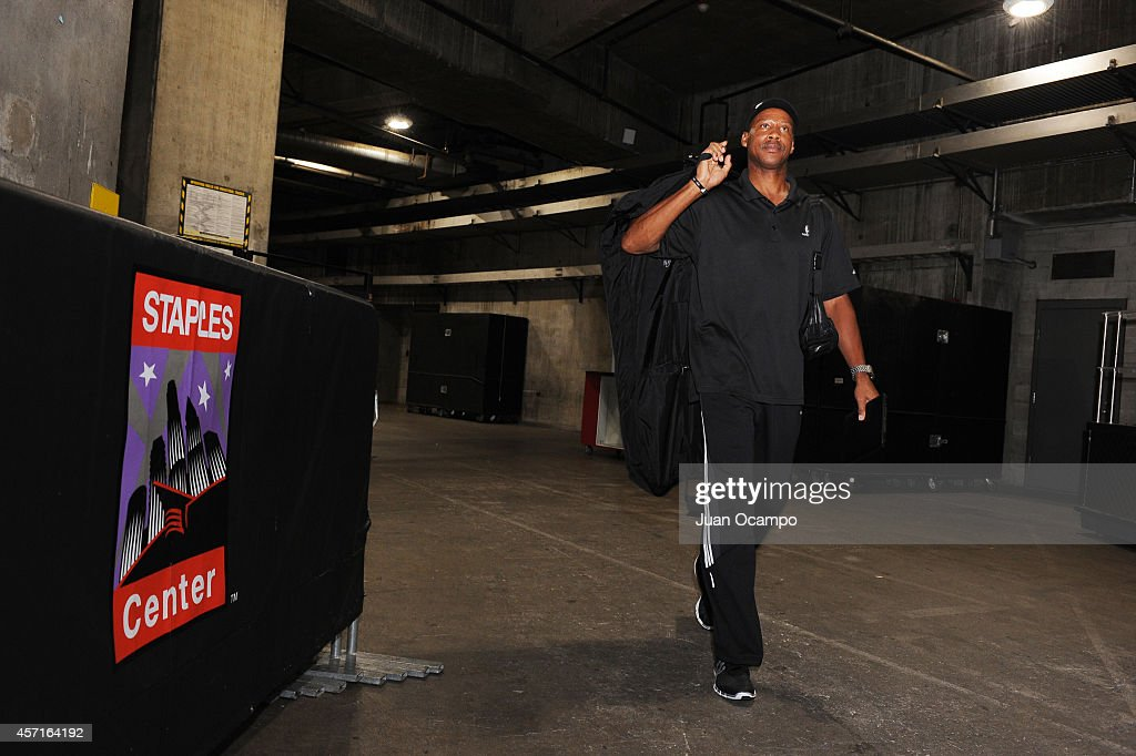 Byron Scott of the Los Angeles Lakers enters the arena before a game versus the Golden State Warriors on October 9, 2014 at the Staples Center in Los Angeles, California.