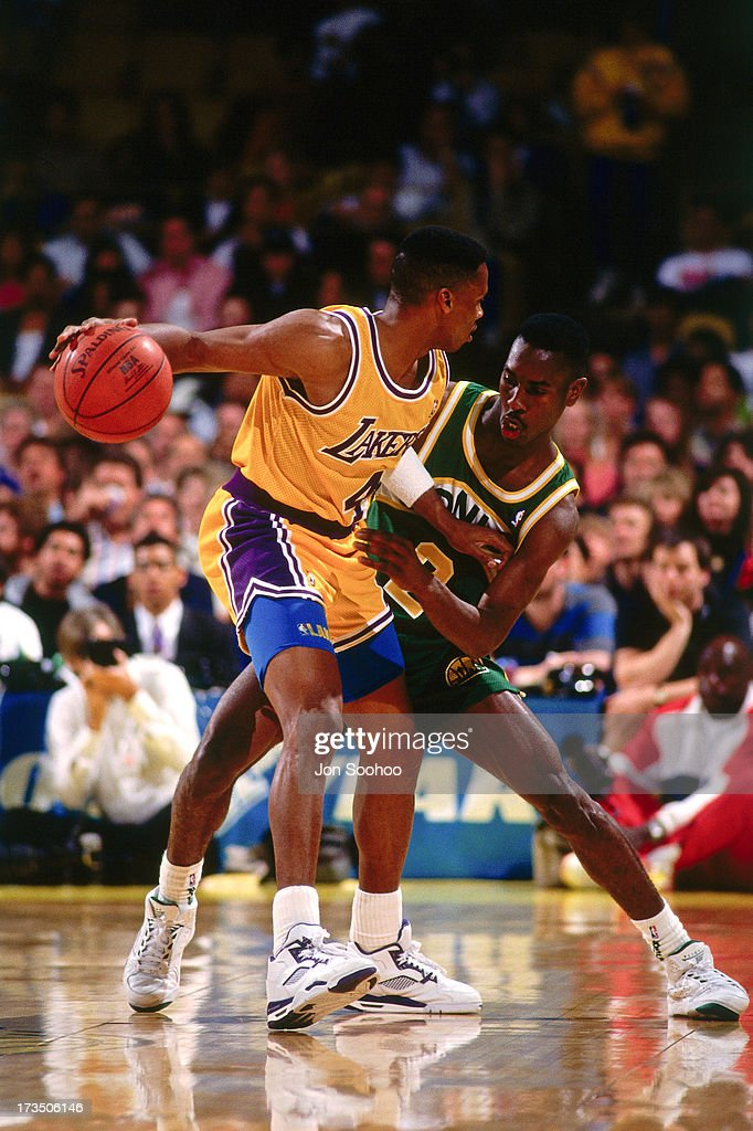 Byron Scott #4 of the Los Angeles Lakers handles the ball against Gary Payton #2 of the Seattle SuperSonics during a game played at the Great Western Forum in Los Angeles, California circa 1991.