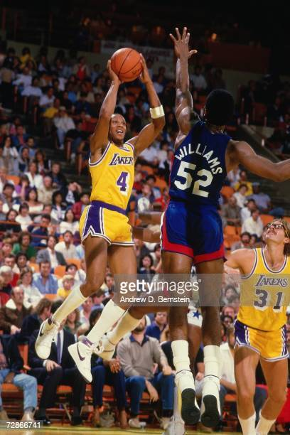 Byron Scott of the Los Angeles Lakers shoots a jump shot over Buck Williams of the New Jersey Nets during a 1985 NBA game played at the Great Western...