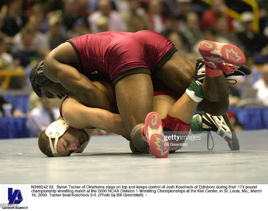 Byron Tucker of Oklahoma stays on top and keeps control of Josh Koscheck of Edinboro during their 174 pound championship wrestling match at the 2000...