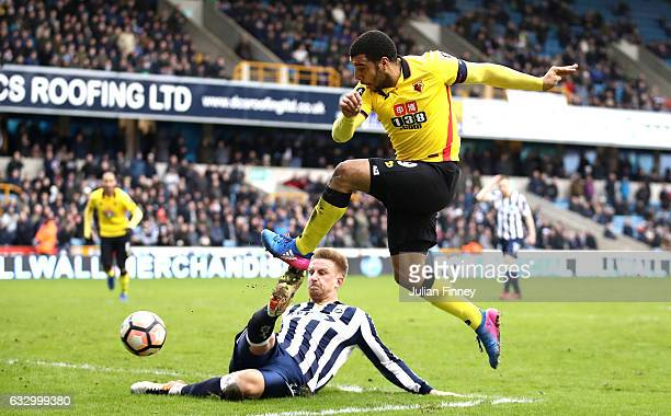 Byron Webster of Millwall attempts to block Troy Deeney of Watford shot during The Emirates FA Cup Fourth Round match between Millwall and Watford at...