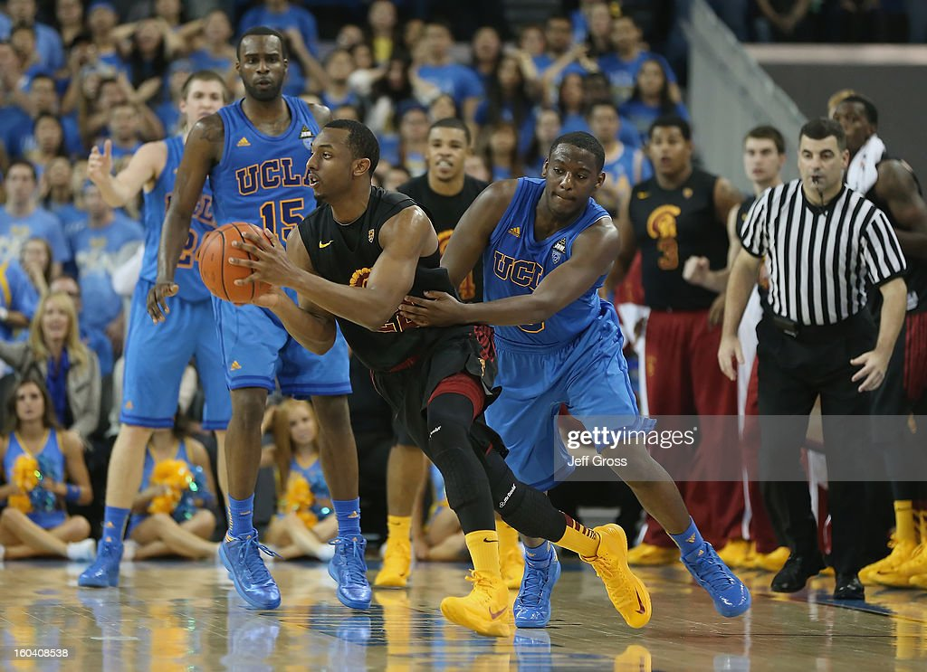 Byron Wesley #22 of the USC Trojans is pursued by Jordan Adams #3 of the UCLA Bruins during overtime at Pauley Pavilion on January 30, 2013 in Los Angeles, California. USC defeated UCLA 75-71 in overtime.