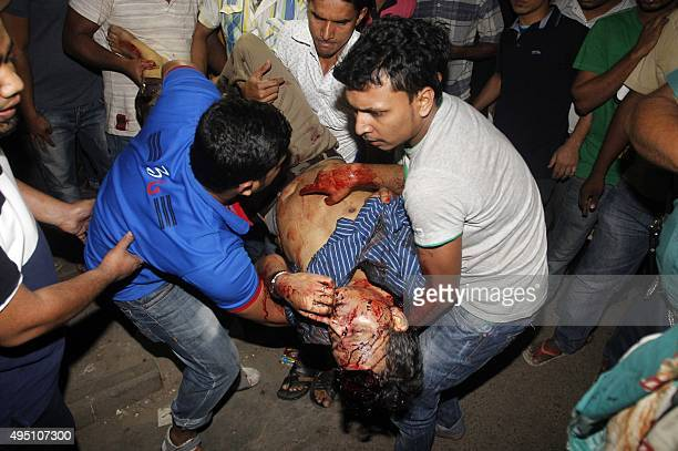 Bystanders carry the body of Bangladeshi publisher Faisal Arefin Dipan to Dhaka Medical College in Dhaka on October 31 after he was hacked in an...