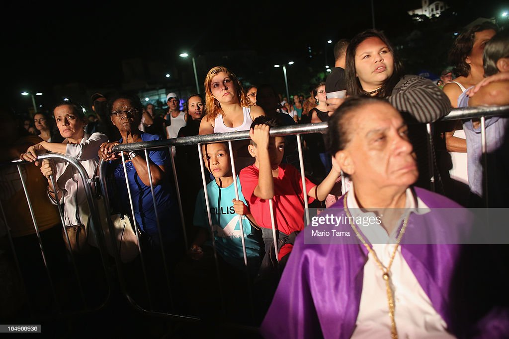 Bystanders watch a Good Friday performance of the life of Jesus following Mass at the Metropolitan Cathedral on March 29, 2013 in Rio de Janeiro, Brazil. Pope Francis is the first pope to hail from South America, with Brazilian Catholics set to receive the pontiff during his visit to Brazil in July for a Catholic youth festival. Brazil has more Catholics than any other country.