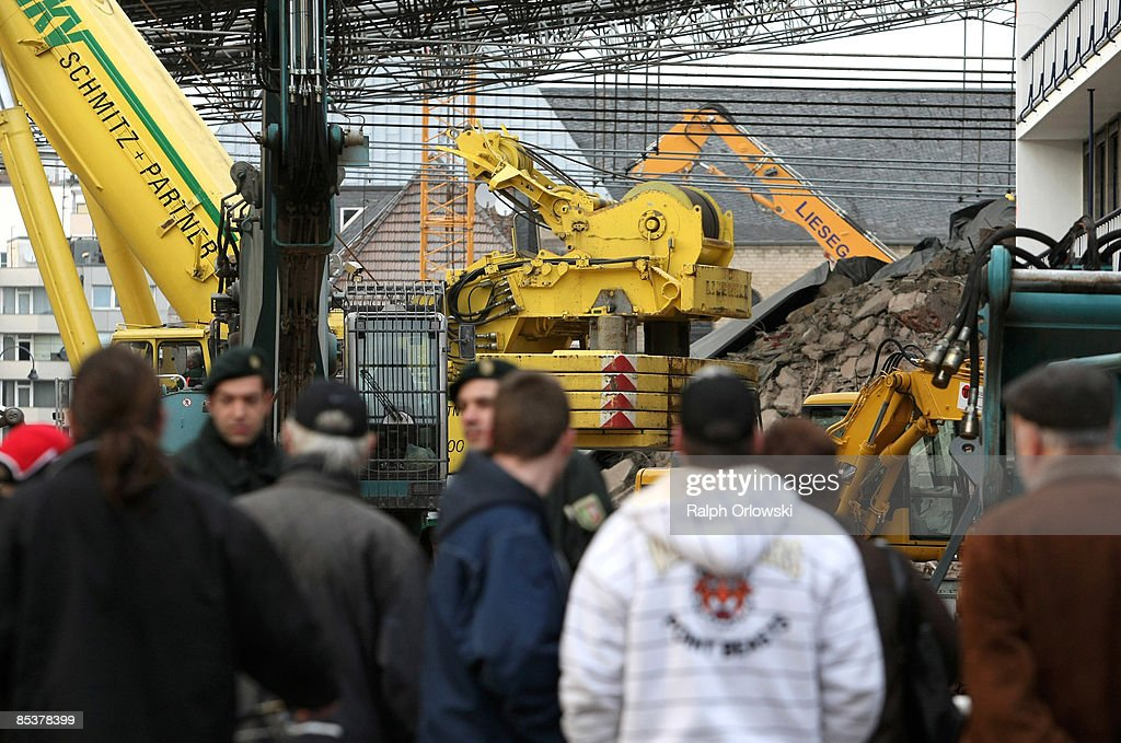 Bystanders watch the site of the ruine of the collapsed Historical Archive of the City of Cologne on March 11, 2009 in Cologne, Germany. Cologne's six-story city archive building collapsed on Tuesday, March 3. The archive building dragged down parts of two adjacent buildings that contained apartments and an amusement arcade. Cologne holds archive material going back over centuries, including manuscripts by communist pioneers Karl Marx and Friedrich Engels and documents related to German writer Heinrich Boell.