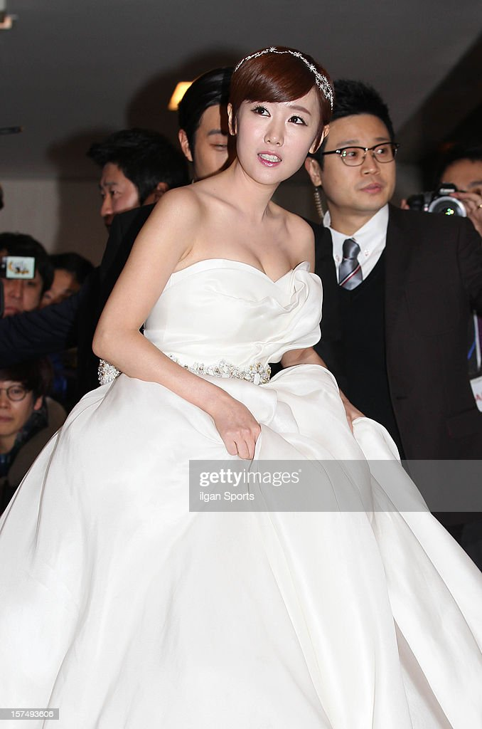 Byul poses for photographs before the wedding ceremony at 63 Building convention center on November 30, 2012 in Seoul, South Korea.