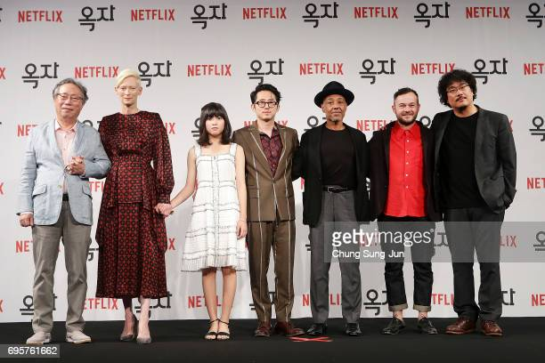 Byun Heebong Tilda Swinton An Seo Hyun Steven Yeun Giancarlo Esposito Daniel Henshall and Bong Joon Ho attend the official press conference after...