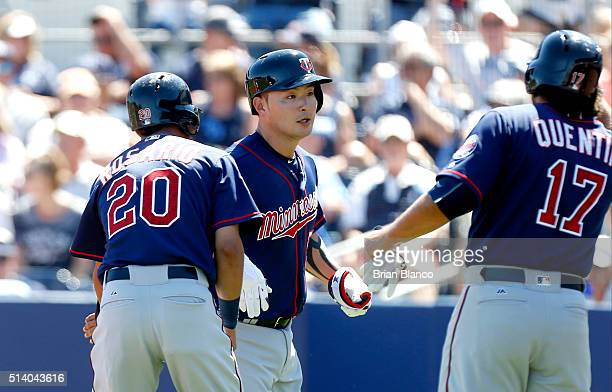Byung Ho Park of the Minnesota Twins celebrates with teammates Eddie Rosario and Carlos Quentin after hitting a grand slam home run off of pitcher...