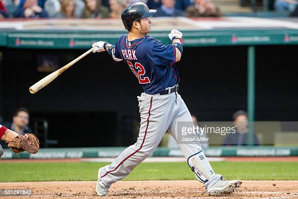 Byung Ho Park of the Minnesota Twins hits a tworun home run during the third inning against the Cleveland Indians at Progressive Field on May 13 2016...