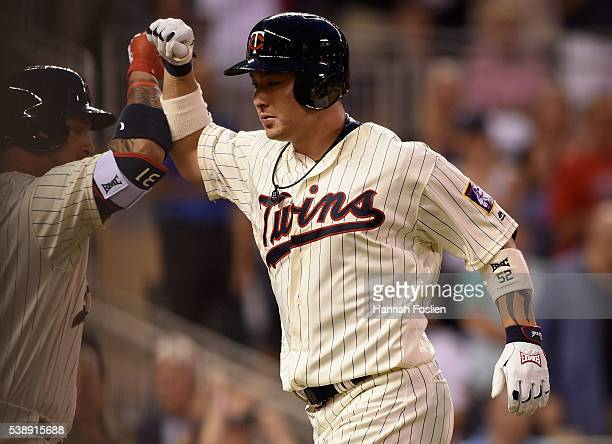 Byung Ho Park of the Minnesota Twins is congratulated by Oswaldo Arcia on his solo home run against the Miami Marlins during the sixth inning of the...