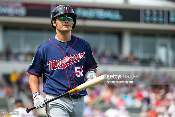 Byung Ho Park of the Minnesota Twins looks on against the Boston Red Sox during a spring training game on March 2 2016 at JetBlue Park in Fort Myers...