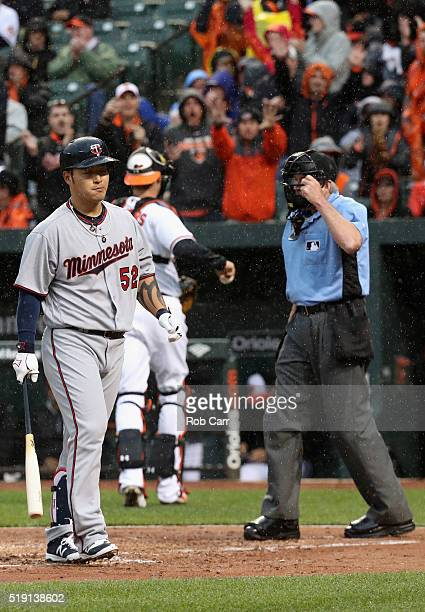 Byung Ho Park of the Minnesota Twins reacts after striking out looking to end the second inning against the Baltimore Orioles in their Opening Day...