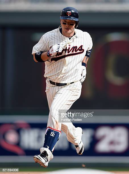 Byung Ho Park of the Minnesota Twins rounds the bases after hitting a solo home run against the Los Angeles Angels of Anaheim during the eighth...
