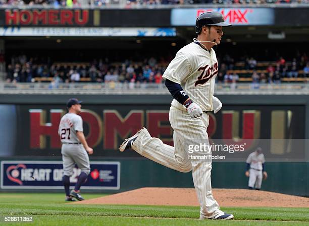 Byung Ho Park of the Minnesota Twins rounds the bases after hitting a solo home run as Jordan Zimmermann and Ian Kinsler of the Detroit Tigers look...