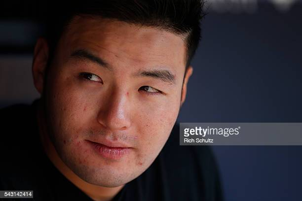 Byung Ho Park of the Minnesota Twins sits in the dugout before a game against the New York Yankees at Yankee Stadium on June 26 2016 in the Bronx...