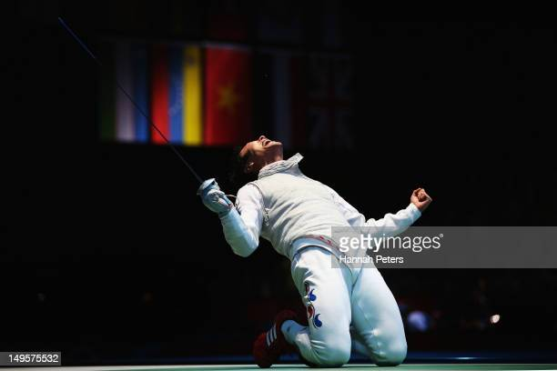Byungchul Choi of Korea celebrates winning his match against Jianfei Ma of China during the quaterfinals of the Men's Foil Individual on Day 4 of the...