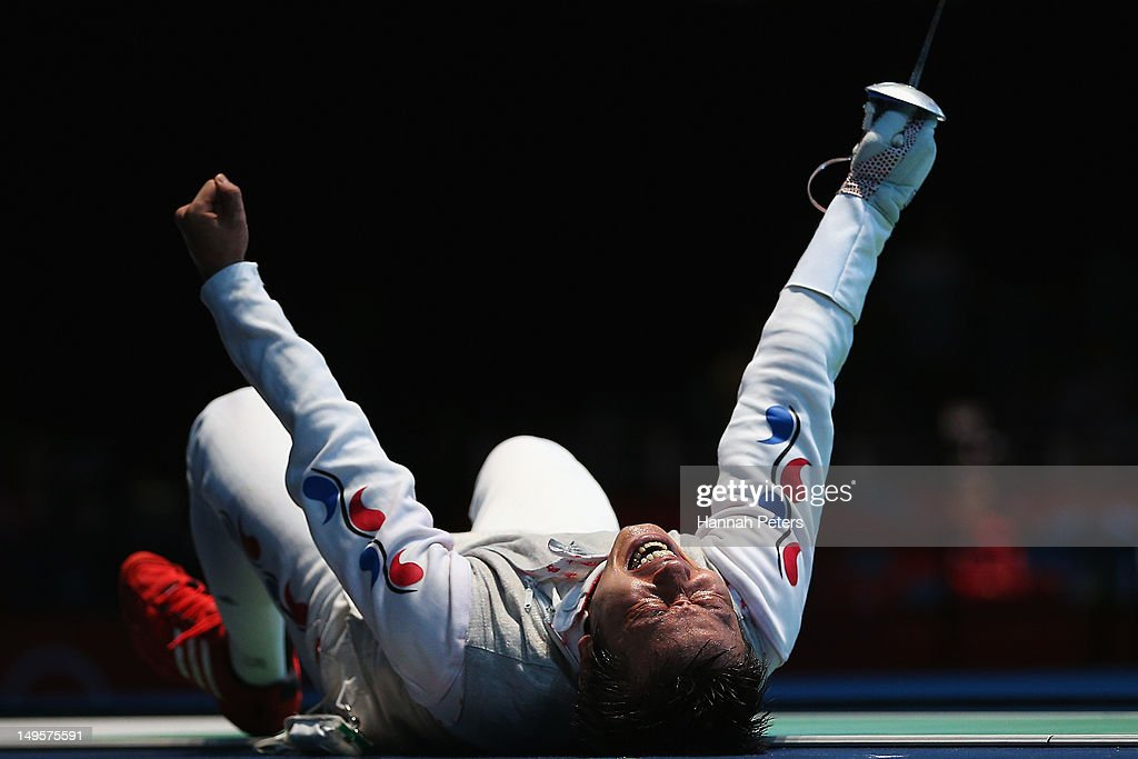 Byungchul Choi of Korea celebrates winning his match against Jianfei Ma of China during the quaterfinals of the Men's Foil Individual on Day 4 of the London 2012 Olympic Games at ExCeL on July 31, 2012 in London, England.