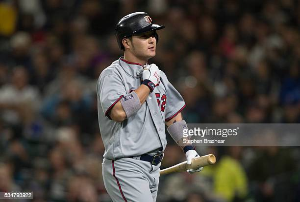 Byungho Park left of the Minnesota Twins walks to the dugout after striking out during the eighth inning of a game against the Seattle Mariners at...