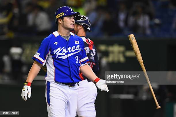Byungho Park of South Korea gets a swing and a miss in the top half of the third inning during the WBSC Premier 12 final match between South Korea...