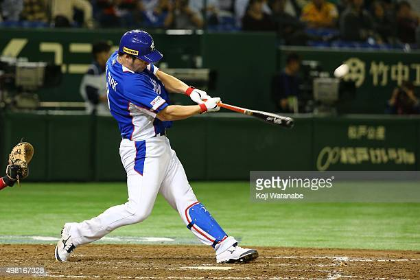 Byungho Park of South Korea hits a threerun homerun in the top half of the fourth inning the WBSC Premier 12 final match between South Korea and the...