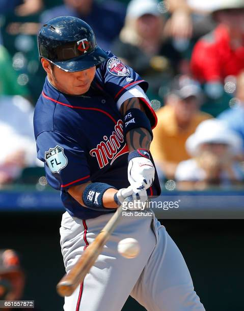 ByungHo Park of the Minnesota Twins hits a home run in the third inning against the Miami Marlins during a spring training baseball game at Roger...