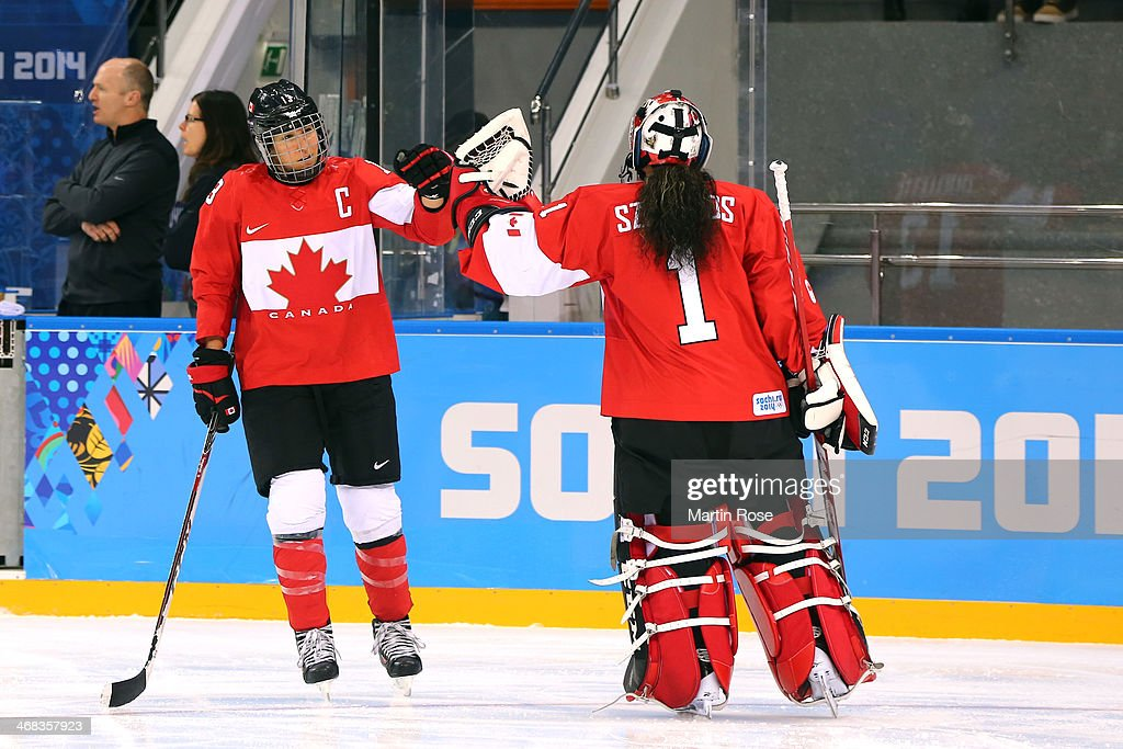 c13 high-fives <a gi-track='captionPersonalityLinkClicked' href=/galleries/search?phrase=Shannon+Szabados&family=editorial&specificpeople=6221604 ng-click='$event.stopPropagation()'>Shannon Szabados</a> #1 of Canada against Finland during the Women's Ice Hockey Preliminary Round Group A game on day three of the Sochi 2014 Winter Olympics at Shayba Arena on February 10, 2014 in Sochi, Russia.