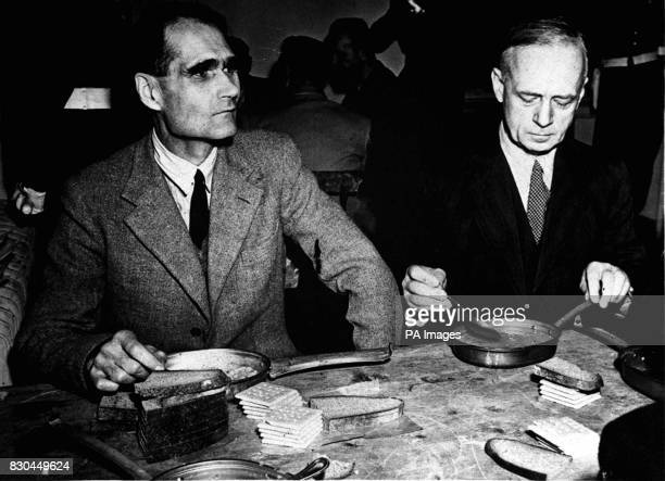 Former Deputy Fuhrer Rudolf Hess and former German Foreign Minister Joachim Von Ribbentrop during a meal at the Nuremberg Court House Bavaria during...