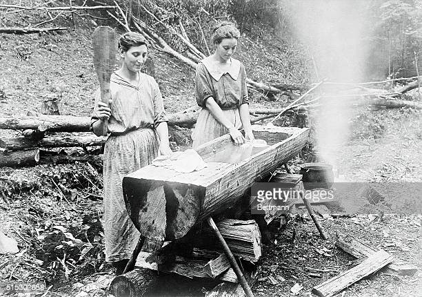 Ca 1880Tennessee Laundry in its primitive stage Two women pounding and washing clothes in wooden trough in the farm district