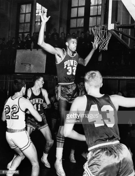 Ca 1964Lew Alciindor playing with Power High Memorial High School is shown leaping in the air during a basketball game with another high school Filed...