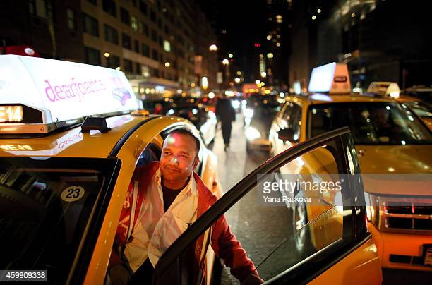 A cab driver watches protesters against the Staten Island grand jury's decision not to indict Daniel Pantaleo the NYPD officer involved in Eric...