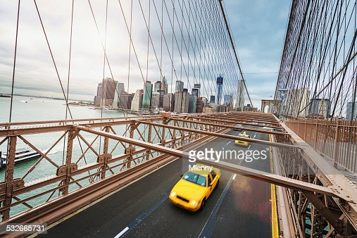 Cab On Brooklyn Bridge In Front Of Manhattan Skyline Stock ...