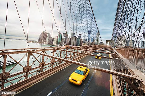 Cab on Brooklyn Bridge in Front of Manhattan Skyline