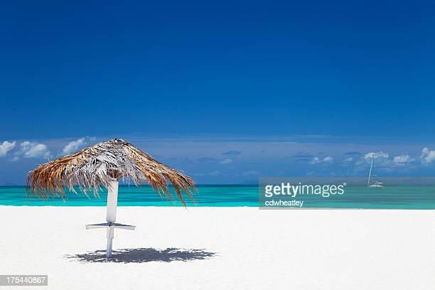 cabana umbrella on a white sand beach in Anegada, BVI