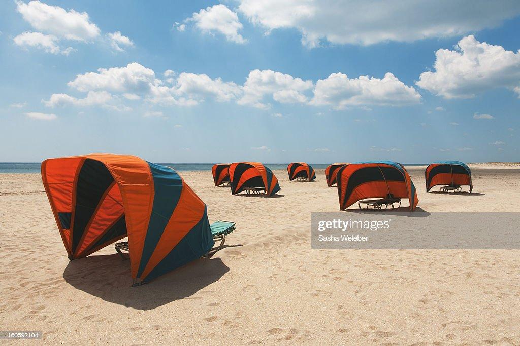 Cabanas on a golden beach : Stock Photo