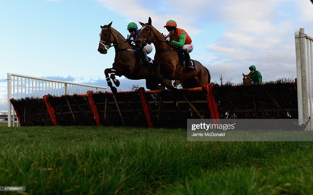 Cabaret Girl riden by Andrew Thornton and Leith Hill Legasi riden by Noel Fehily jump the last during the Like StanJamesBet on Facebook Mares Novices...