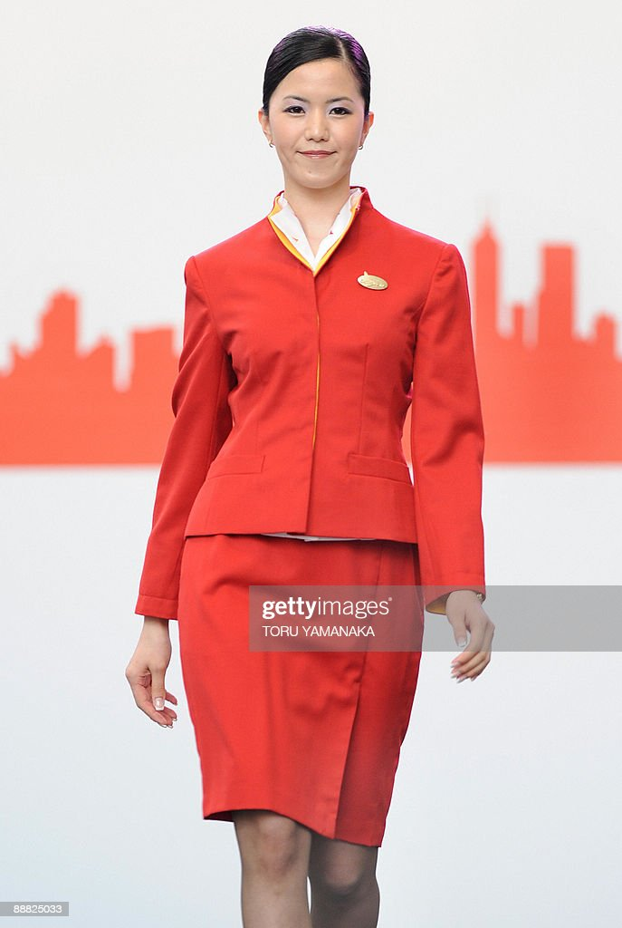 A cabin attendant of Cathay Pacific displays the current uniform of the Hong Kongbased airlines during the fashion show to introduce the transition...