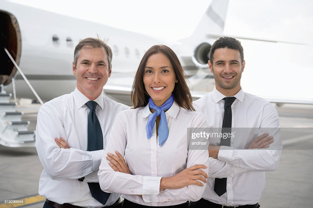 Cabin crew at the airport : Stock Photo