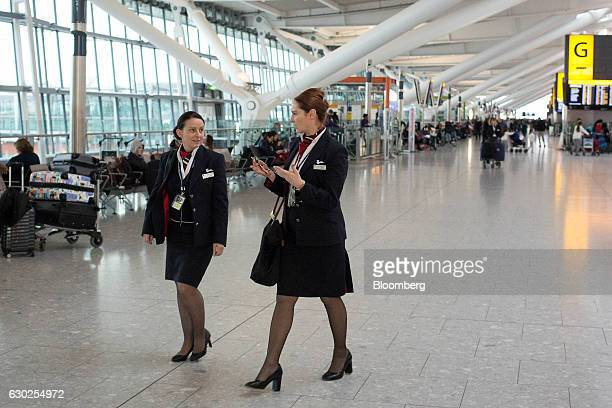 Cabin Crew employed by British Airways a unit of International Consolidated Airlines Group SA walk through Terminal 5 at London Heathrow Airport as...