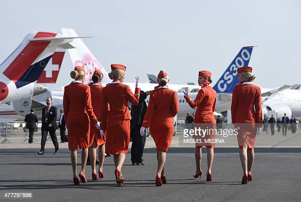Cabin crew of the Russian airline Aeroflot walk past during the International Paris Airshow at Le Bourget on June 16 2015 AFP PHOTO /MIGUEL MEDINA