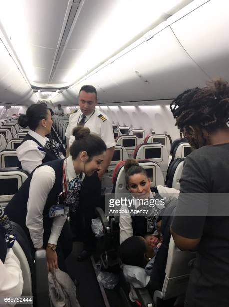 A cabin crew of Turkish Airlines pose for a photo with a baby born in a plane during a flight from Conakry to Ouagadougou to Istanbul on April 7 2017...