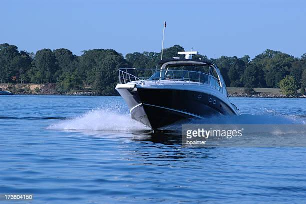 Cabin cruiser under power