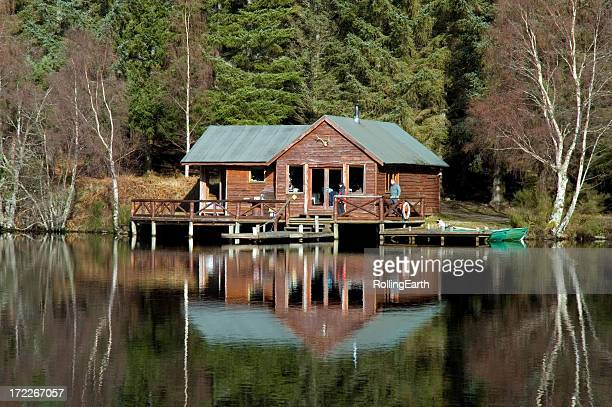 Cabin in the middle of a clear lake
