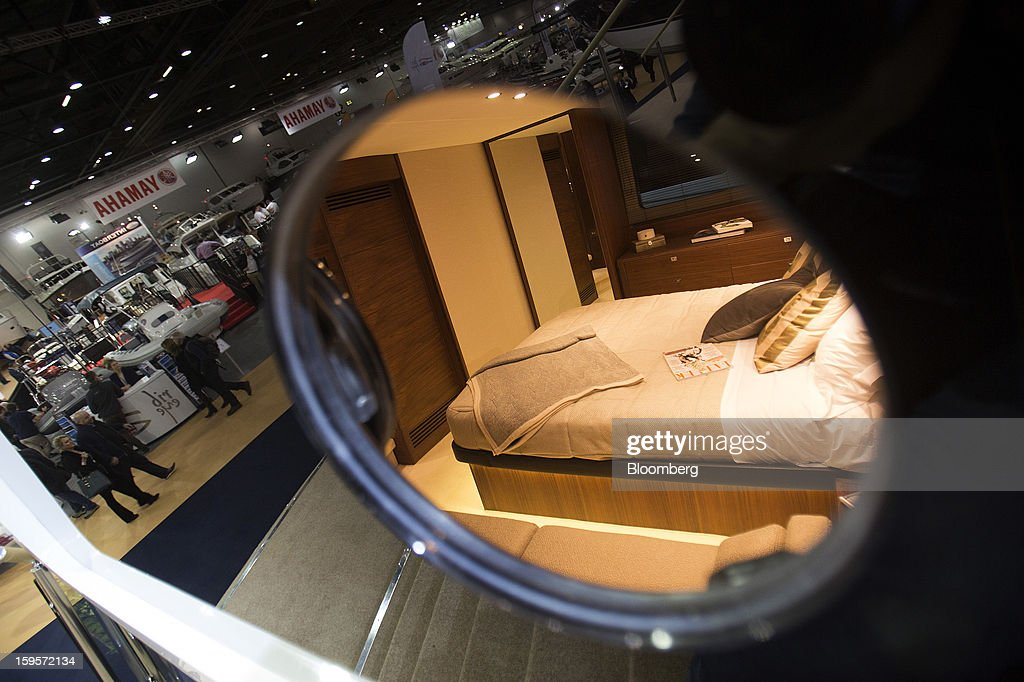 A cabin is seen through a porthole window of a luxury yacht manufactured by Princess Yachts International Plc, part of the LVMH Moet Hennessy Louis Vuitton SA group, during the Tullet Prebon London Boat Show 2013 at the ExCeL center in London, U.K., on Wednesday, Jan. 16, 2013. The show, Europe's first in 2013, will showcase new sailing craft from dinghies to luxury yachts, and runs Jan. 12-20. Photographer: Simon Dawson/Bloomberg via Getty Images